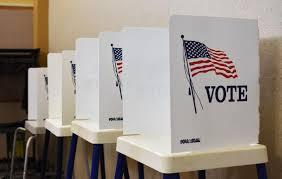 Group of ballot boxes with American flags on the side